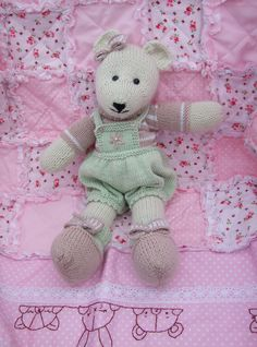Candy - knitted with alpaca and organic cotton, she is sitting on a pink rag quilt.