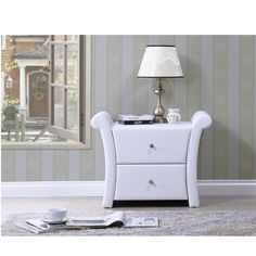 This small elegant bedside table is a fine solution to any bedroom setting. The subtle design consist of a clean matte white finish. Consisting of two storage drawers, it allows plenty of space for your precious belongings.
