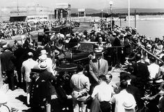 FDR in Chattanooga speaking at the opening of the Chickamauga Dam in 1940. He is surrounded by people while getting out of his car.