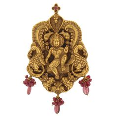 Prince Jewellery - Antique Jewellery Collections. Gold pendant (ponnula kadukkan) with a swami relief representation of a four-armed Vishnu. Wearing a traditional ornaments of Tamil Nadu , with a single head snake and two fishes on the top. A leaf design has been embossed outer to hold the snake and fish, beside the Vishnu two peacocks embossed (the ratham of lord murugan).