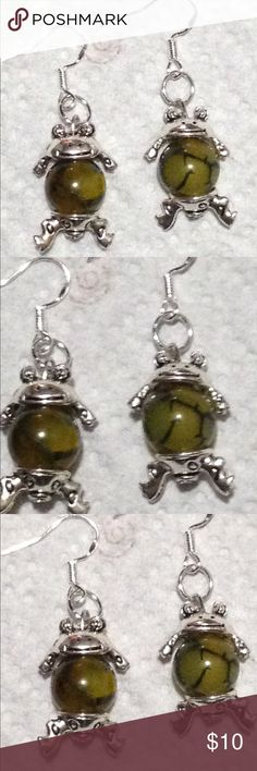 Green Frog Dragon's Vein Agate Earrings  These cool frog earrings are made with green dragon's vein agate. Because these are natural stones, each one will vary slightly in appearance. The hooks are sterling silver. All PeaceFrog jewelry items are made by me! Take a look through my boutique for coordinating pieces and more unique creations. PeaceFrog Jewelry Earrings