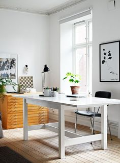 bright and airy workspace with large dining table as desk