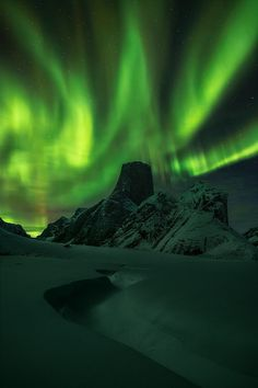 Mount Asgard in the Baffin Mountains, Nunavut, Canada ..photo: 'Over the Asgard' by Artur Stanisz