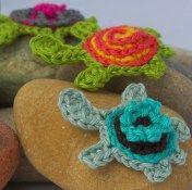 - Colorful turtle applique on a rocky landscape