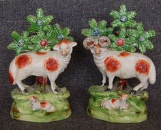EARLY 19TH CENTURY STAFFORDSHIRE PAIR OF SHEEP, ONE EWE AND ONE RAM HOLLOW BASE