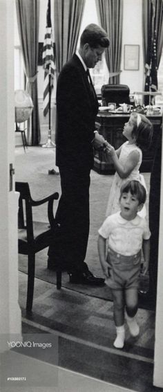 John F. Kennedy with his children at the White House