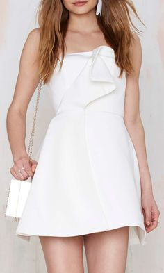 a cute white strapless dress perfect for a bridal shower, engagement party or bachelorette party.