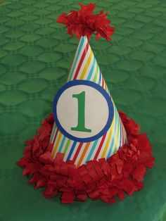 First birthday. Party hat. Rainbow/ primary color birthday party.
