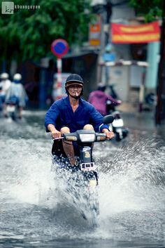 Saigonese, riding in rain like a boss