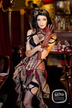 Crimson Steampunk Burlesque (brown and tan brocade underbust corset with matching high low hem skirt, tan brown leather gloves, goggles, necklace and pocket watch, black bra, black garters with thigh high fishnet stockings, collar) - For costume tutorials https://www.steampunkartifacts.com