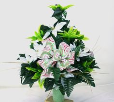 Beautiful Green & White Poinsettia's Christmas Cemetery Flower Arrangement.The arrangements is trimmed with greenery and pine cones that make this arrangement perfect for the Christmas Holiday Sea