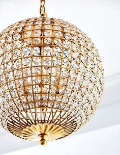 Brass-framed crystal chandelier {PHOTO: Stacey Brandford}
