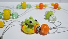 Cute frog glass lampwork bead pendant... green frog on orange and yellow bead long necklace. by BdazzledJewellery on Etsy
