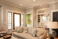 The wall color is SW7064 Passive in an Eggshell finish by Sherwin-Williams. The trim color is Sherwin-Williams SW7005 Pure White, Semi-gloss.. by Renewal Design-Build
