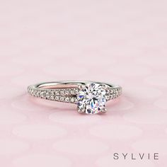 This stunning split shank engagement ring features carats of shimmering diamonds cascading down both sides of it's unique split shank. Split Shank Engagement Rings, Classic Engagement Rings, Beautiful Engagement Rings, Designer Engagement Rings, Diamond Engagement Rings, Bridal Rings, Wedding Ring Bands, Diamond Girl, Proposal Ring