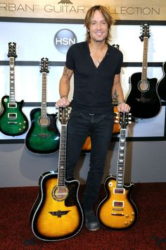 Double the fun. Keith Urban debuts the Urban Guitar Collection on HSN on Oct. 4 in Tampa, Fla.
