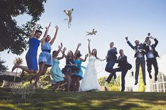 Jumping for joy!  But no reason to throw the cats.  I hope its not going to catch on as a new wedding tradition!  by Dorset wedding photographer, Linus Moran.  www.LinusMoranPhotography.co.uk  Linus Moran Photography Prospect House, Peverell Ave East, Dorchester, Dorset. DT1 3WE  01305 755663