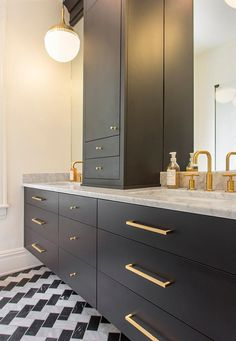 Black and white honed marble bathroom with brass Kohler Purist faucets. Lesley Glotzl - residential interiors.