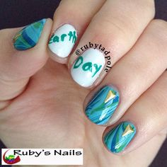 Earth Day watermarble nail art plus triangle studs from http://www.bornprettystore.com/20pcsset-delicate-isosceles-triangle-nail-studs-fashion-nail-decoration-p-16677.html