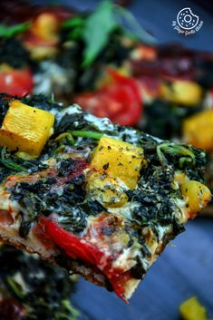 Garlicky Spinach Mango Tomato Pizza with Hot Pepper Sauce and Flakes