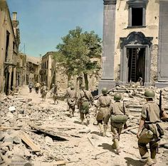 Operation Husky, the Allied invasion of Sicily. US troops drive along the ruins in Piazza SMartino in Randazzo, Sicily. Us Congress Library,