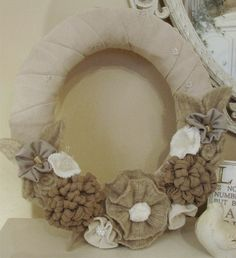 upcycled Sweater wreath in shades of beige, taupe and creamy whites.