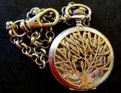 1 LEFT. Your choice as a pocket watch or a necklace. 1st photo shows pocket watch style with key chain clasp. Steampunk Tree of Life bronze 12 Pocket Watch by THEMAGICKWIZARD, $12.99