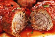 These slow-cooked beef rolls stuffed with proscuitto and basil are the centerpiece of a traditional Italian Sunday dinner.These slow-cooked beef rolls stuffed with proscuitto and basil are the centerpiece of a traditional Italian Sunday dinner. Beef Dishes, Food Dishes, Entree Dishes, Beef Cutlets, Beef Braciole, Meat Recipes, Cooking Recipes, Dishes Recipes, Healthy Recipes