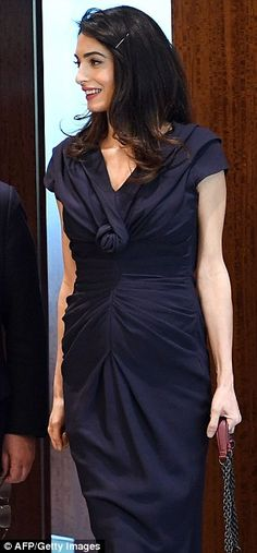 Pregnant Amal Clooney spent Friday back at the U.N. as she continues to fight for victims of ISIS militants.  She is pushing for the U.N. investigate Islamic State crimes