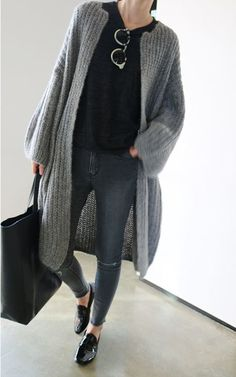 A grey knit open cardigan and charcoal distressed skinny jeans are a great outfit formula to have in your arsenal. Add black leather loafers to your look for an instant style upgrade.   Shop this look on Lookastic: https://lookastic.com/women/looks/open-cardigan-crew-neck-t-shirt-skinny-jeans/18888   — Black Crew-neck T-shirt  — Grey Knit Open Cardigan  — Charcoal Ripped Skinny Jeans  — Black Leather Tote Bag  — Black Leather Loafers