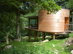Luxury tree houses UK, amazing small space created using a Douglas Fir frame by Carpenter Oak Ltd. Create your own funky garden cabin