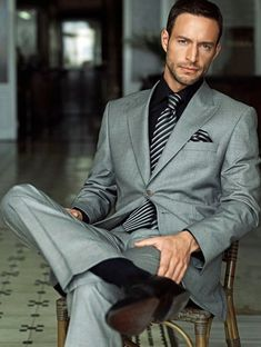 Nice gray suit, but striped tie and pocket square really add that special touch.