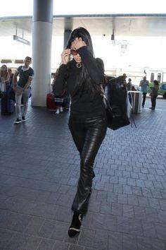 Kourtney Kardashian wearing Mansur Gavriel Leather Backpack, Chloe Isadora Sunglasses, J Brand Centro Sweater in Black and RTA Kiki Leather Crop Flare Pants