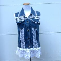 I love working with lace and upcycled denim. I get a feel good repurposing  a garment knowing that I've saved it from clogging up our landfills. This cowgirl inspired jean vest is being listed in our etsy shop today; size medium. Stef of DragonflyDenim