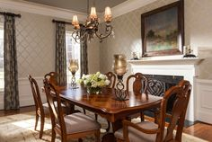 Loving the fireplace in the dining room! #wallpaper #chandelier #draperies