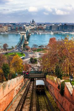 BUDAPEST, HUNGARY ~ CLIMBING CASTLE HILL :  A tram makes its way up Castle Hill in Budapest with the Chain Bridge in the background.