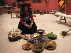 Woman showing how to dye yarn in Chinchero, Cuzco.