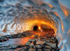 This snow tunnel near the Mutnovsky Volcano in Russia is almost a kilometre long. These tunnels form under the snow fields in deep ravines at the end of the summer thaw. Meltwater flows through glaciers towards lower elevations, finding an outlet at the terminus of the glacier and carving the ice on the way. The Mutnovsky Volcano is found in the southern part of the Kamchatka Peninsula. Photo credit: Michael Zelensky