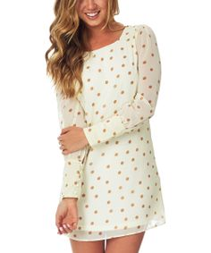 White dress with gold polka dots, would go good with a gold pair of leggings and some white high heels