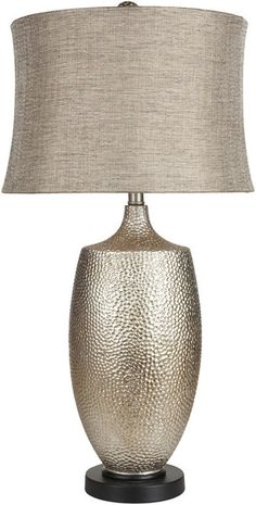 The textured design of this table lamp's base is just so beautiful! It reminds me of seashells for some reason