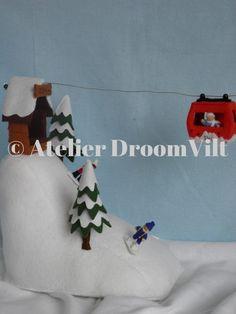 Skihelling/ Sneeuwhelling met kabelbaan- atelier droomvilt