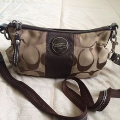 Small Coach Purse  Brown Coach purse.... I try to keep and take care of all of my belongings, so this purse is still in great shape there is some wear at the bottom of purse but not noticeable when your wearing it. Inside of bag is clean no stains! All reasonable offers will be considered!  Coach Bags