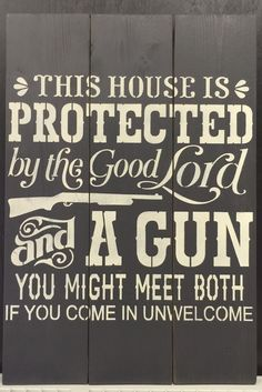 "Indoor planked wooden pine sign:  THIS HOUSE IS PROTECTED BY THE GOOD LORD AND A GUN YOU MIGHT MEET BOTH IF YOU COME IN UNWELCOMED. 16.5""x24"" $44.99"