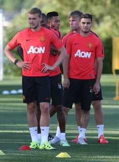 James Wilson and Andreas Pereira in line