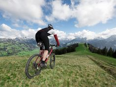 Making the switch from road riding to mountain biking is tougher than you might think. Use these tips and drills to learn how to ascend and descend hills with power and style.
