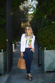 dark pleated trousers + citrus print top + white blazer