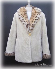 Oyster Sheared Beaver and Bobcat Jacket #OSB748; $2000.00; Like New Condition; Approx. size range: 4 - 8. This is a stunning genuine dyed oyster sheared beaver fur jacket with natural bobcat fur collar and trim in impeccable, pristine condition, which looks as if it has never been worn. It features a large bobcat fur notched collar, straight sleeves with bobcat trim cuffs and slits at the sleeve ends.  A recent appraisal showing the present value to be $8000 will be included with your purchase.