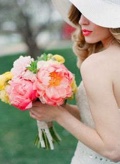 Gorgeous coral and yellow Peony bouquet. #spring #wedding #flowers