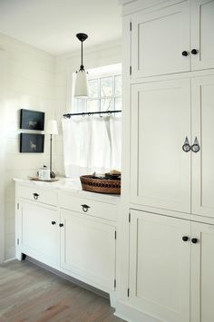 linen storage, laundry room cabinets.