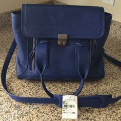 Authentic Colbalt 3.1 Phillip Lim Pashli Medium Perfect Colbalt blue. Has tag from Nordstrom. Probably one of the most practical bags ever- very structured and well made. Huge inside pocket. No flaws aside from a scratch on the snap. Please request additional photos and I am happy to email them ☺️ No trades or PayPal. No dust cover. Used for a few months on and off. 3.1 Phillip Lim Bags